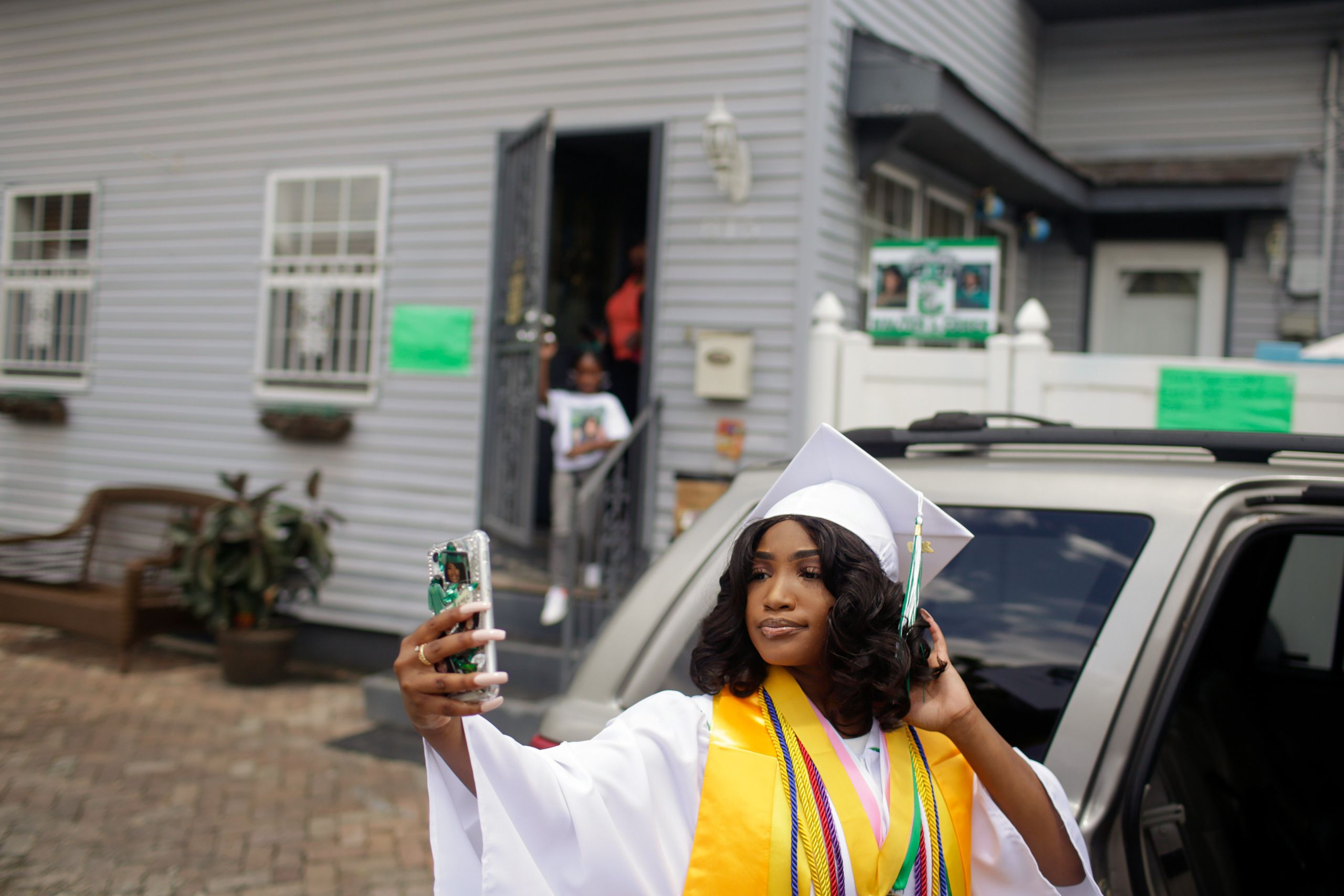 Satoriya Lambert takes a selfie before heading to her high school graduation ceremony on May 27.