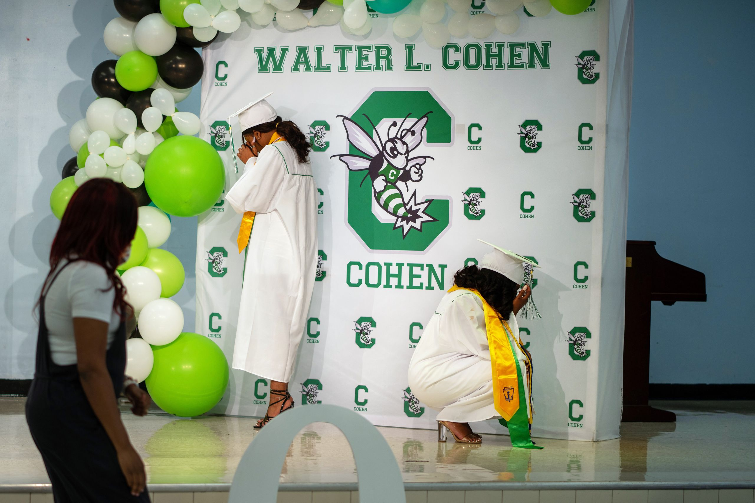 Jade Brown, left and Satoriya Lambert break down in tears as they sing their school song at Walter L. Cohen College Prep. Bec