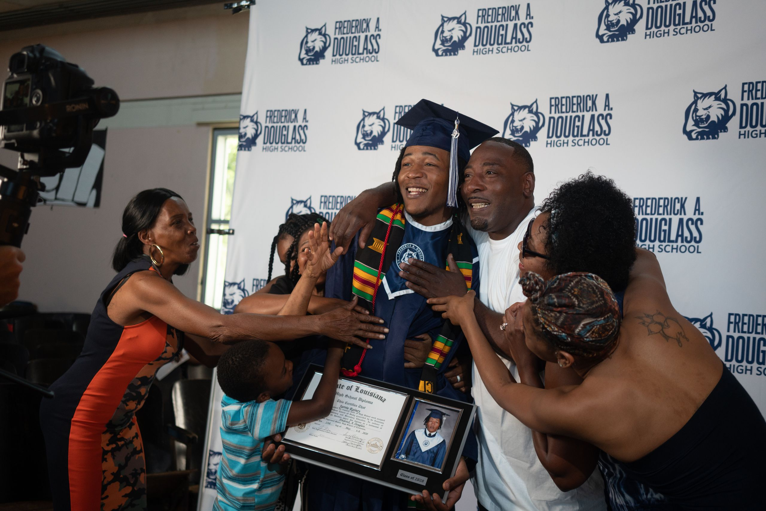 Jarrin Rainey celebrates with his proud family, including grandmother Sheila Rainey, left, after his graduation ceremony at F