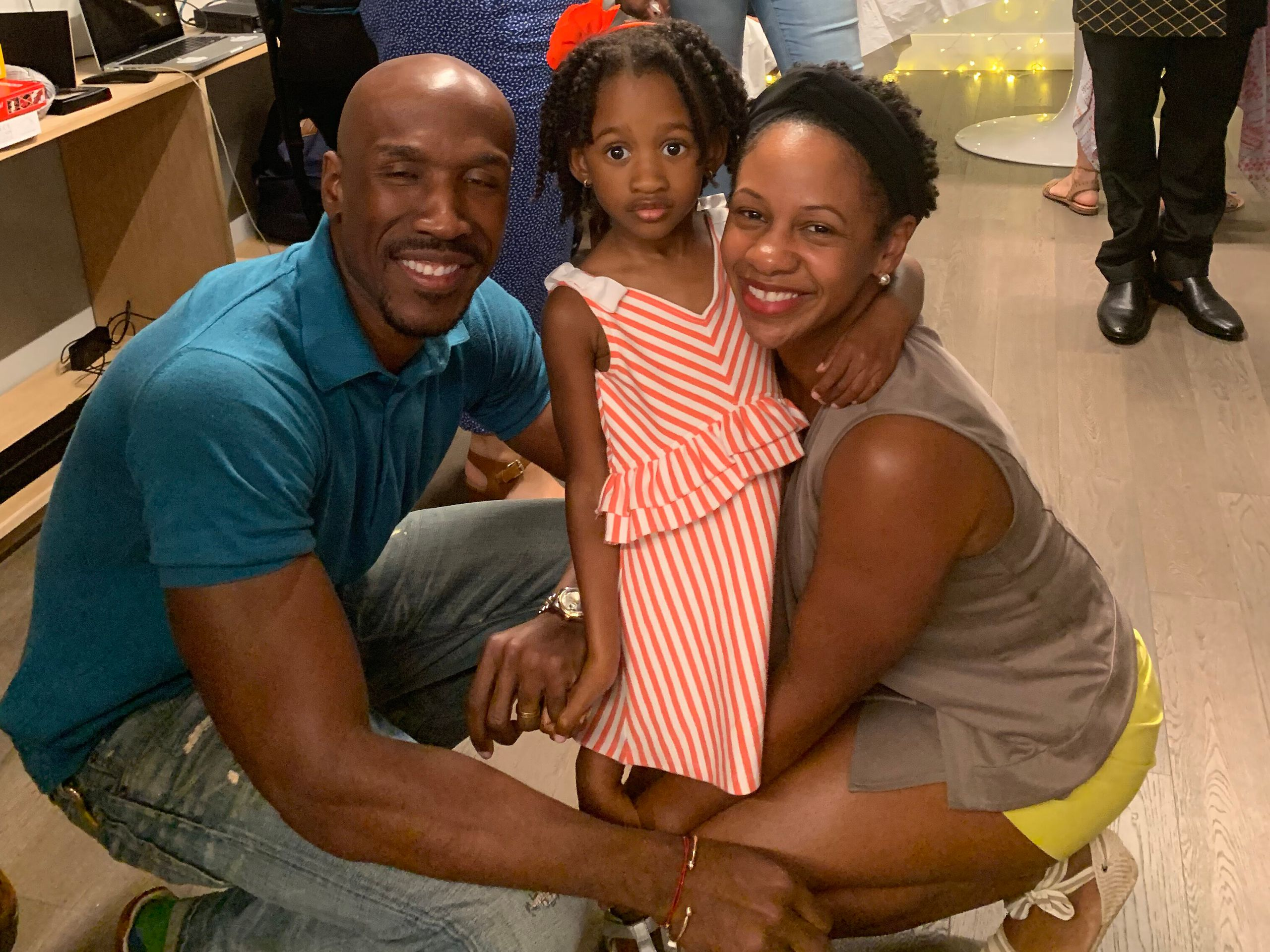 Ernest, Presley and Tamiesha Parris pose for a family photo at a small gathering in Queens, back when such gatherings were a