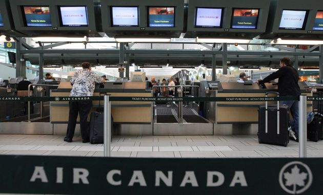Air Canada passengers check in at the Vancouver International Airport on June 17, 2008. Air Canada has...