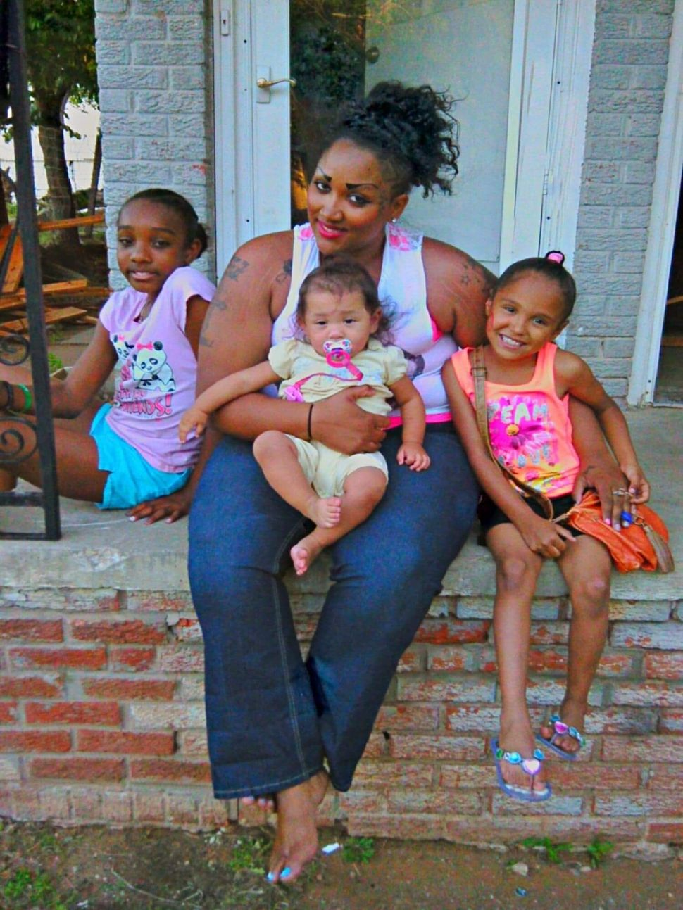 Brittany Jefferson with her three daughters: Lela, Victoria and Alejandra. Jefferson is awaiting release from prison this yea
