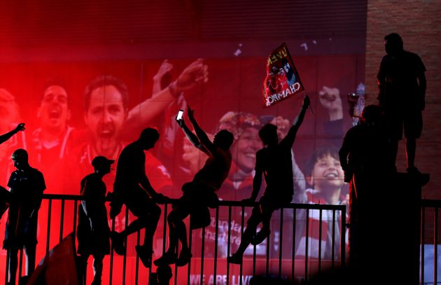 Liverpool fans celebrate outside Anfield,