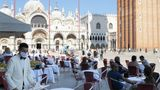 VENICE, ITALY - JUNE 13: Waiters wearing protective face masks work on the patio facing San Marco Square in Venice, Italy, on JUNE 13, 2020. Italy has eased the lockdown aimed at curbing the spread of the COVID-19 infection. (Photo by Federico Vespignani/Anadolu Agency via Getty Images)