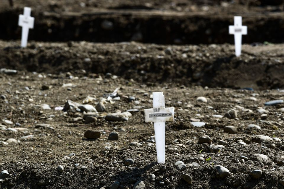 At the Maggiore cemetery in Milan, graves of unclaimed coronavirus victims are marked with a simple plastic...