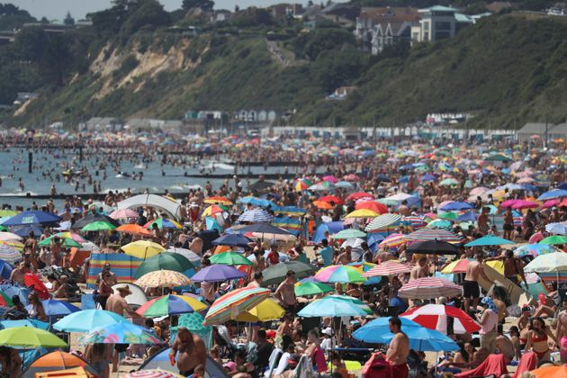 Crowds gather on the beach in Bournemouth as the UK experience a heat wave, in Bournemouth, England,...