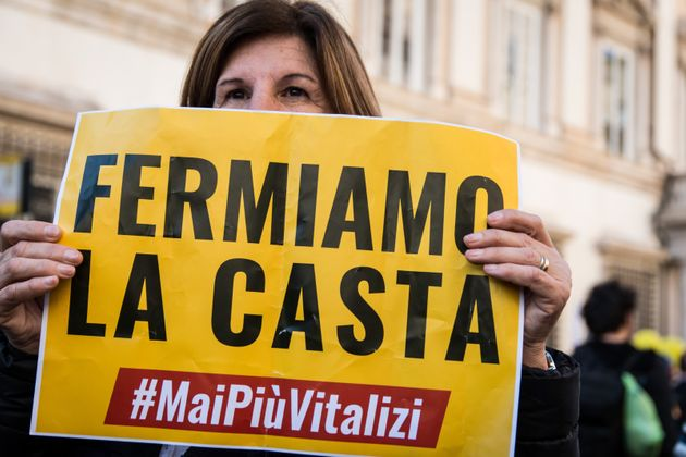 Demonstrators take part in a rally called by the Five-Star Movement to protest against members of parliament...