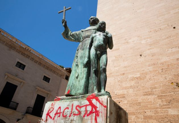 A statue of Catholic St. Junipero Serra in Palma de Mallorca, Spain, on Monday after it was daubed with...