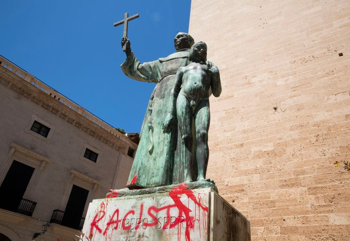 "A statue of Catholic St. Junipero Serra in Palma de Mallorca, Spain, on Monday after it was daubed with graffiti reading ""rac"