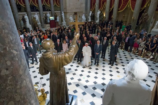 Pope Francis pauses in front of a sculpture of Junipero Serra in Statuary Hall at the U.S. Capitol in...