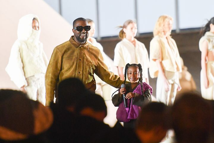 """Kanye West and his daughter North West on the runway during the """"Yeezy Season 8"""" show in March in Paris. West is starting a l"""