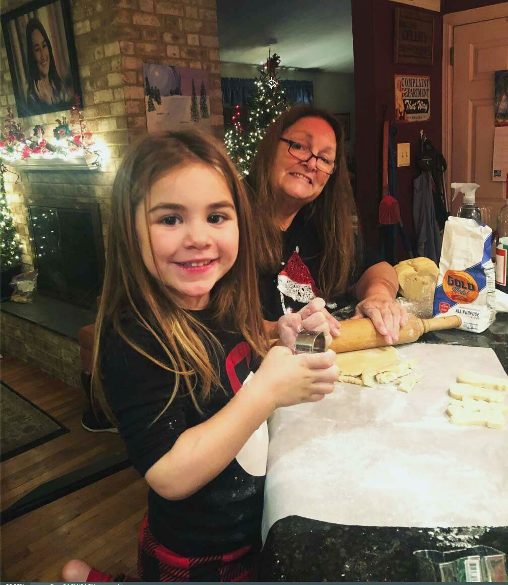 Joanne H. Clough and her granddaughter, Carter, make Christmas cookies in December 2019.