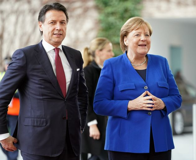 19 January 2020, Berlin: Federal Chancellor Angela Merkel (CDU) receives Giuseppe Conte (l), Prime Minister...