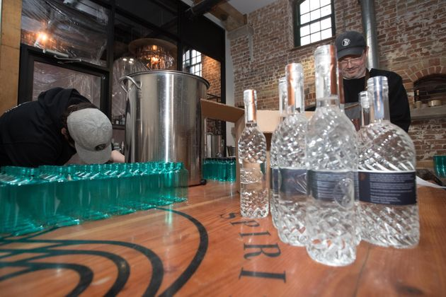 Staff at Spirit of York distillery in Toronto make hand sanitizer, March 19,