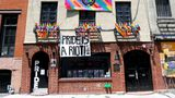 NEW YORK, NEW YORK - JUNE 20: Pride flags and Black Lives Matter signs decorate The Stonewall Inn on June 20, 2020 in New York City. Due to the ongoing Coronavirus pandemic, this year's march had to be canceled over health concerns. The annual event, which sees millions of attendees, marks its 50th anniversary since the first march following the Stonewall Inn riots. (Photo by Jamie McCarthy/Getty Images,)