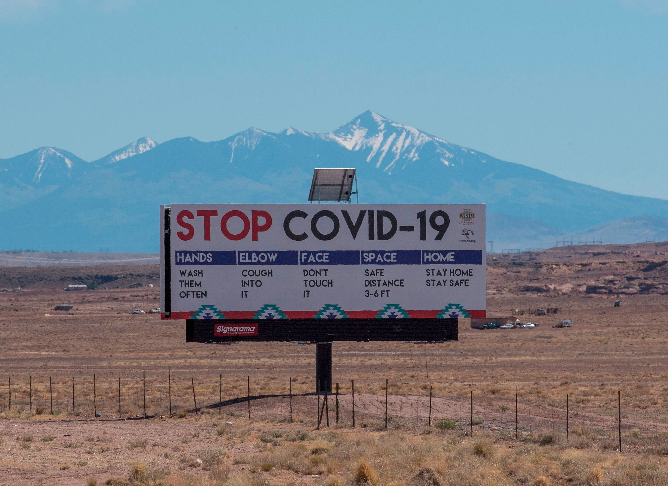 A sign warns against the COVID-19 virus near the Navajo Nation town of Tuba City, Arizona, on May 24.