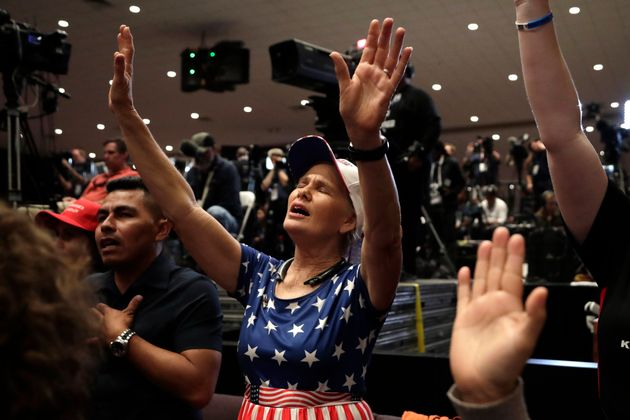 Wanda Albritton of Miami Springs, Florida, raises her arms in prayer at a rally for evangelical supporters...