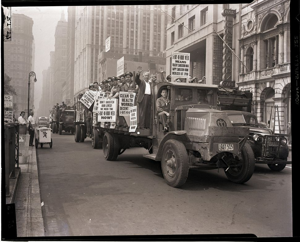 Sanitation workers demonstrate for a five-day, 40-hour workweek in New York in 1952.