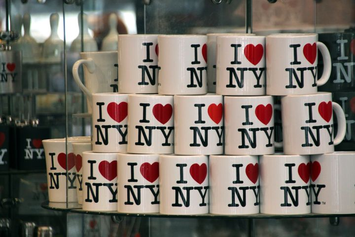 "Mugs with the ""I ❤️ NY"" logo on sale at a souvenir shop."