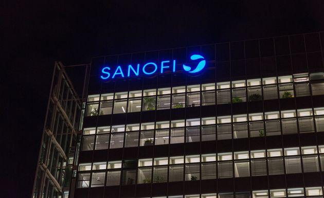 BERLIN, GERMANY - NOVEMBER 13, 2018: City night Potsdamer Platz office building with Sanofi logo. Sanofi...