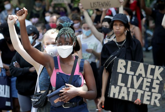Two young woman take part in a Black Lives matter anti-racism protest rally in Berlin, Germany, Saturday,...
