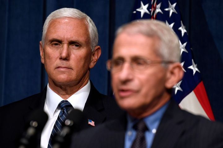Director of the National Institute of Allergy and Infectious Diseases Dr. Anthony Fauci, right, speaks during a news conference with members of the Coronavirus task force, including Vice President Mike Pence, left, at the Department of Health and Human Services in Washington, Friday, June 26, 2020. (AP Photo/Susan Walsh)