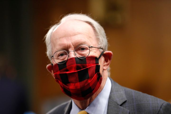 Sen. Lamar Alexander, R-Tenn., wears a plaid face mask before chairing the health committee, which held a hearing in May on n