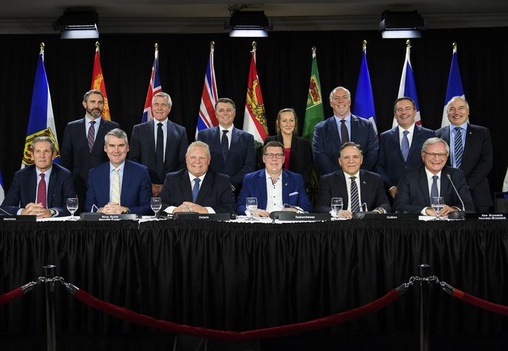 Canada's premiers pose for a photo after speaking to the media during a meeting of the Council of the Federation, which comprises all 13 provincial and territorial leaders, in Mississauga, Ont. on Dec. 2, 2019.