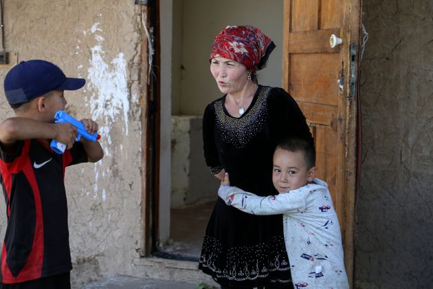 Alif Baqytali hugs his mother, Gulnar Omirzakh, at their new home in Shonzhy, Kazakhstan. Omirzakh, a...