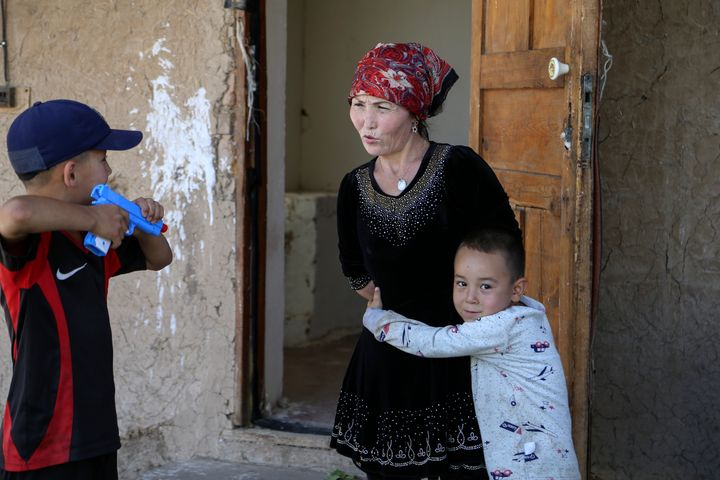 Alif Baqytali hugs his mother, Gulnar Omirzakh, at their new home in Shonzhy, Kazakhstan. Omirzakh, a Chinese-born ethnic Kaz