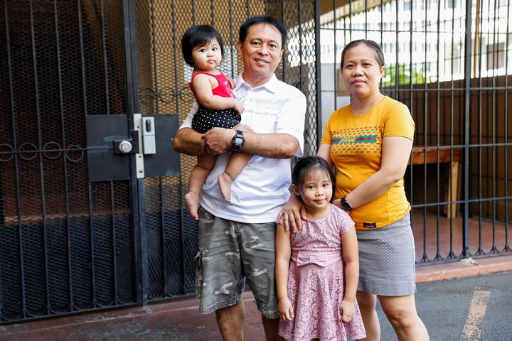 Judith and Jose Ramirez, a housekeeper and an electrician who were both temporarily laid off from their jobs at the Sheraton Waikiki Hotel due to the business downturn caused by the coronavirus outbreak, pose with their daughters Mary Amber, 1, and Mary Ashley, 5, outside their home in Honolulu, Hawaii, U.S. April 29, 2020.
