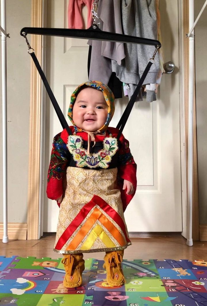 Six-month-old Brave Yazzie of Onion Lake, Sask. gets ready for a dance session.