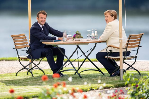 GRANSEE, GERMANY - JUNE 29: German Chancellor Angela Merkel and French President Emmanuel Macron sit...