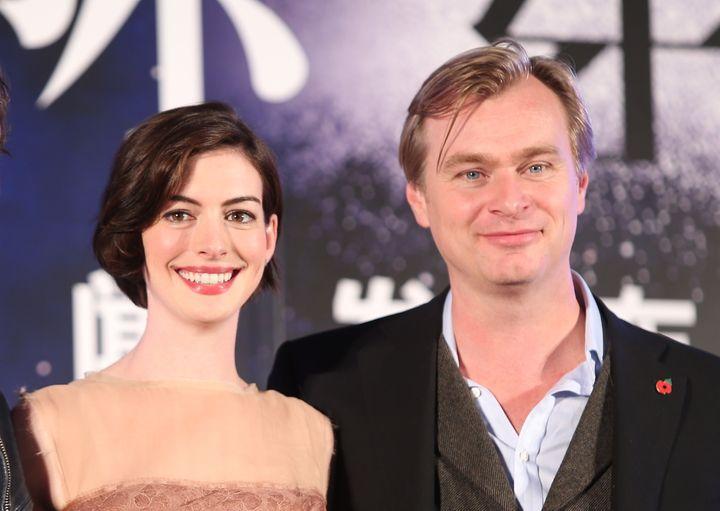 "Anne Hathaway and director Christopher Nolan promote ""Interstellar"" in 2014."