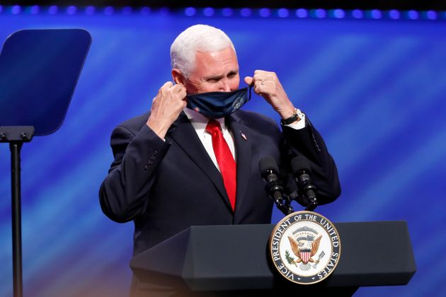 Vice President Mike Pence removes his mask to make comments at First Baptist Church