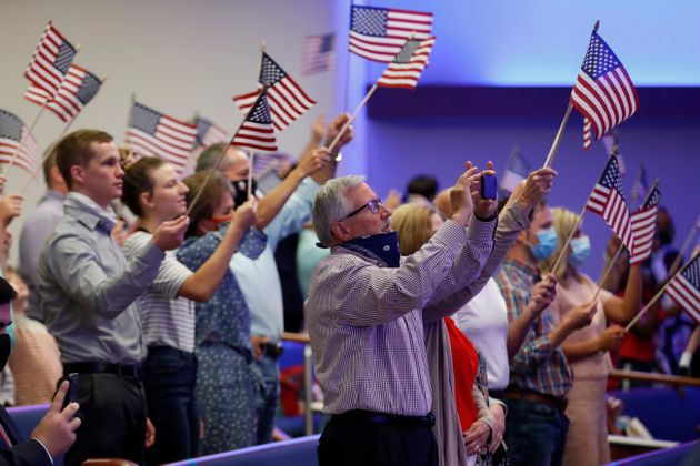 Attendees wave flags at First Baptist Church Dallas on June 28,