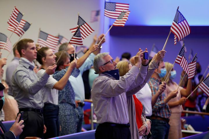 Attendees wave flags at First Baptist Church Dallas on June 28, 2020.