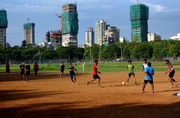 Boys playing football at Dadar Shivaji Park maidan, on June 9, 2020 in