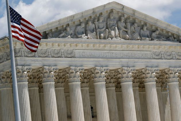 An American flag waves in front of the Supreme Court on Capitol Hill in Washington, Monday, June 29,...