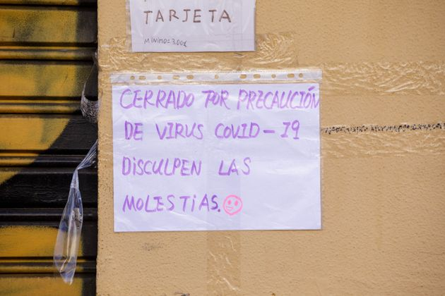Sign announcing a store closing in Madrid due to Covid-19 on March 14, 2020, in Madrid, Spain. (Photo...
