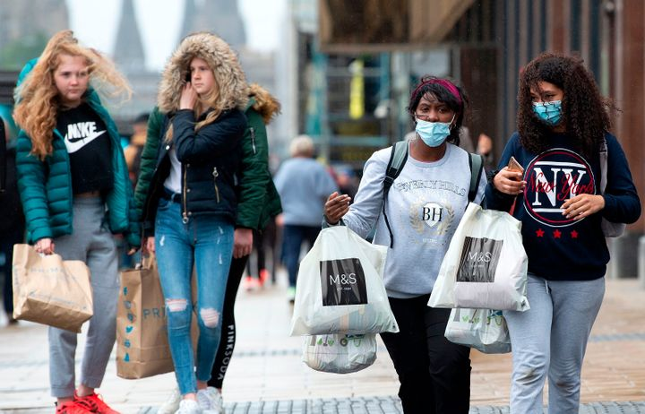 Shoppers in Scotland. Some are wearing masks, others aren't.