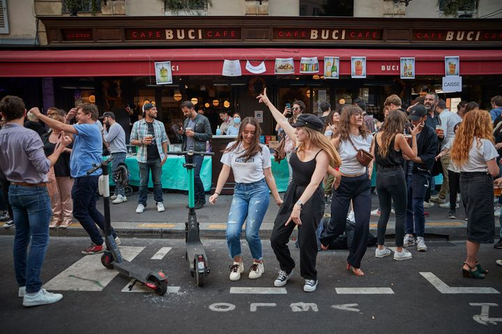 Parisians dance in the street in the 6th Arrondissement as Paris celebrates the first day of summer with Fete de La Musique with bands playing across the city on June 21.