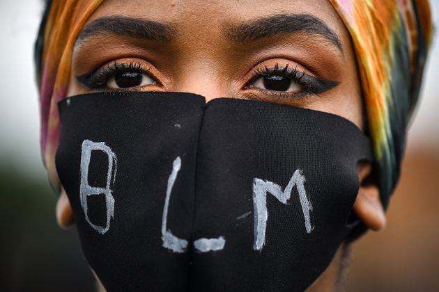 EDINBURGH, UNITED KINGDOM - JUNE 07: A woman with mask at the Black Lives Matter protest in Holyrood...