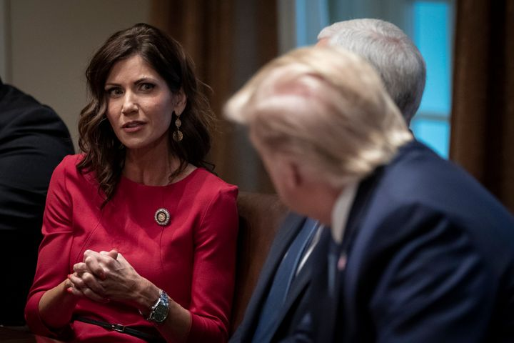 South Dakota Gov. Kristi Noem (R) and President Donald Trump at a meeting in December. The president is planning to speak at