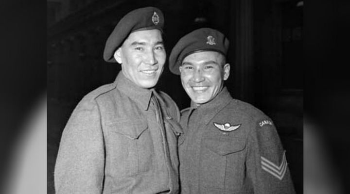Tommy Prince, right, with a brother at Buckingham Palace in London, where he was awarded two gallantry medals in 1945.