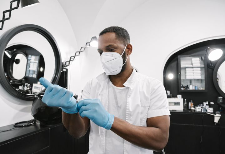 Gloves and personal protective equipment are an extra step of protection that salon staff may use considering the long periods of time spent inside, but likely won't ask customers to.