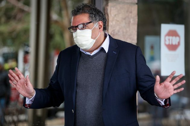 Calgary Mayor Naheed Nenshi pictured wearing a mask at a senior's home in Calgary on April 14,