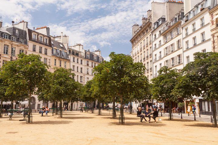 Place Dauphine on the Ile de la Cite, Paris. It was initiated by Henry IV in 1607.
