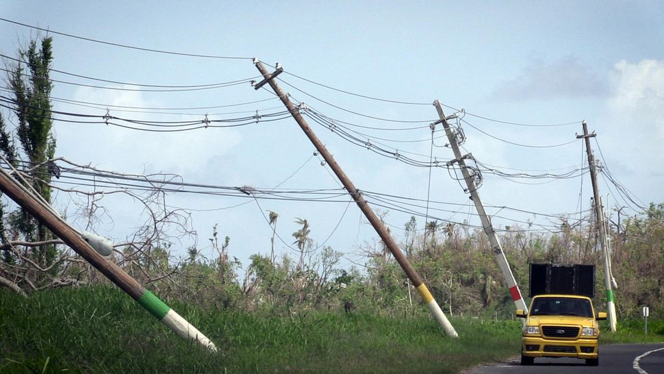 Power lines hang precariously on the side of the road on Highway 118, near San Isidro, Puerto Rico.