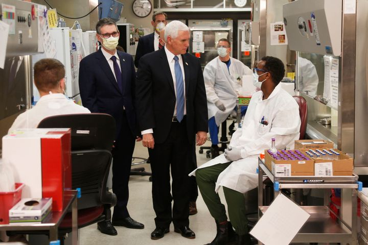 Vice President Mike Pence visits the molecular testing lab at the Mayo Clinic in Rochester, Minnesota. Pence chose not to wear a face mask, an apparent violation of the medical center's policy.